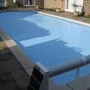 Solar powered automatic swimming pool cover.